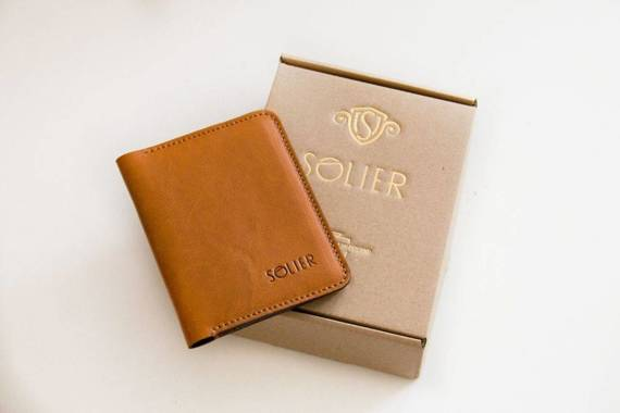 Elegancki czarny skórzany męski portfel SOLIER SW04B